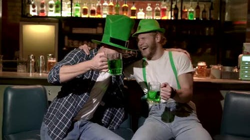 The company of young people celebrate St. Patrick's Day