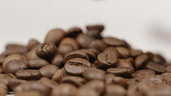 Thumbnail for Coffee bean falls on a coffee beans pile