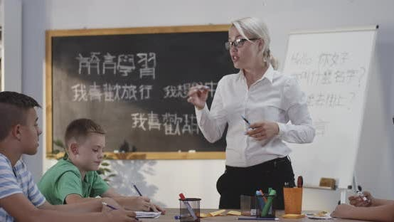 Thumbnail for Teacher Explaining To Pupils in a Chinese Language Class