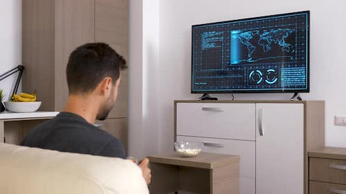 Man Playing a Strategic Video Game on the Console