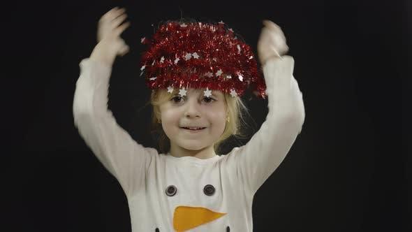 Happy Beautiful Baby Girl in Snowman Costume