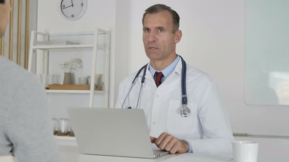 Thumbnail for Doctor Discussing with Patient in Clinic, Health Treatment