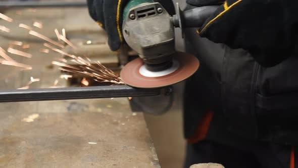 Polishing Metal Bar In A Workshop