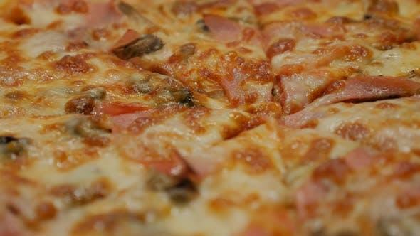 Details of Italian pizza surface tasty junk food 4K 2160p 30fps UltraHD tilting footage - Slow tilt