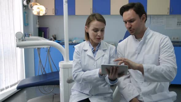 Thumbnail for Dentists Discussing Patient's Diognosis on Tablet