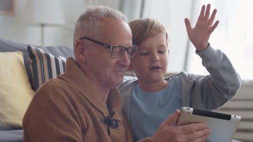 Granddad Having Fun with Grandson