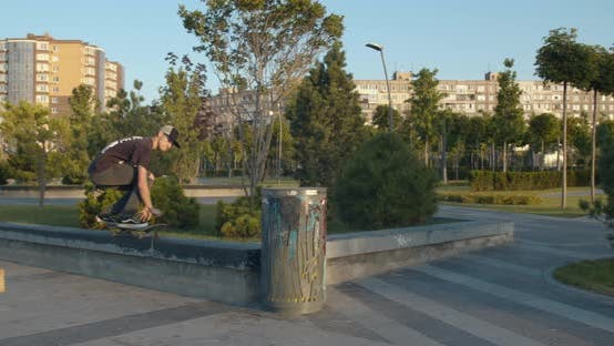 Thumbnail for Skater Failing a Kickflip After a High Jump Over a Trash Can,