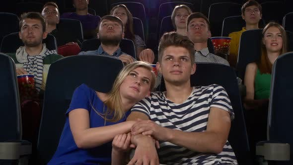Thumbnail for Couple in Cinema Watching a Movie, and Kissing
