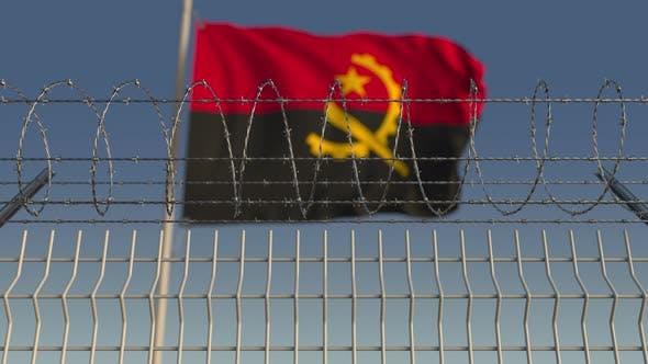 Thumbnail for Winkende Flagge von Angola hinter Stacheldrahtzaun