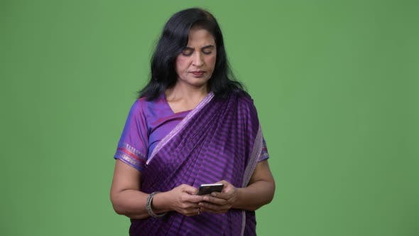 Thumbnail for Mature Happy Beautiful Indian Woman Using Phone