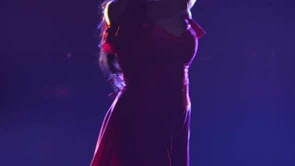 Camera Pans Over Slender Body of Woman in Red Dress Dancing Passionate Flamenco