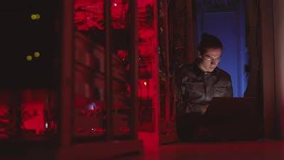 Coder Working in Dark Datacenter