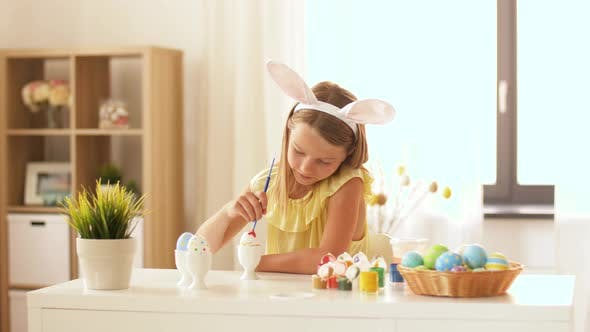Thumbnail for Happy Girl Coloring Easter Eggs at Home