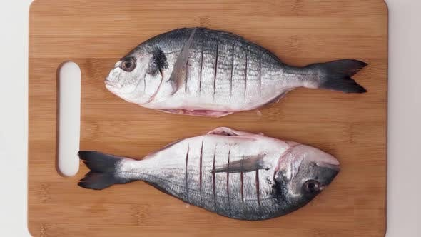 Top view of process of cooking fish
