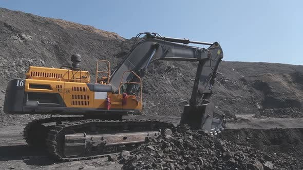 Thumbnail for Excavator Digs on a Coal Mine