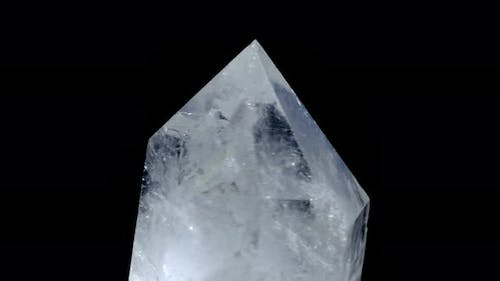 Healing Crystal Stone Macro Mineral, White Rough Quartz Crystals on Black Background. Mystery