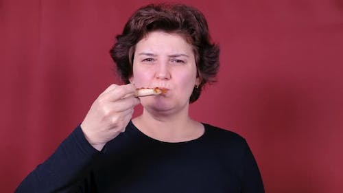 Woman Eating Pizza. Healthy and Junk Food Concept. Diet.