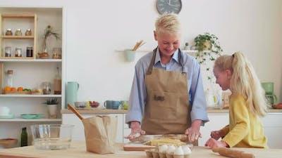 Grandma and Granddaughter Cooking
