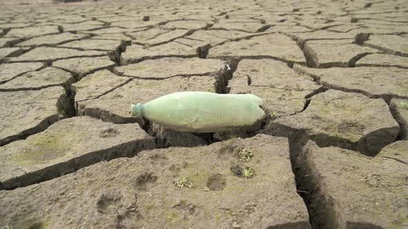 Thumbnail for Empty Plastic Bottle Sitting on Dried Out Dam in Bulgaria. Studena Dam Near Pernik