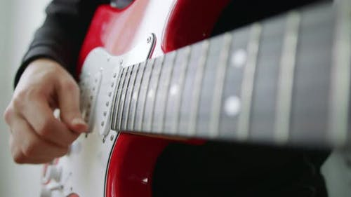 A Male Hand While Playing an Electro Acoustic Guitar