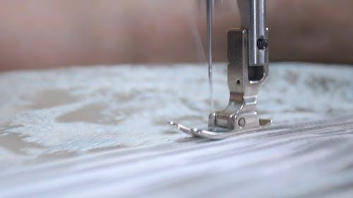 Designer working with sewing machine