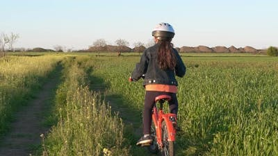 Ride bike leisure in the village.