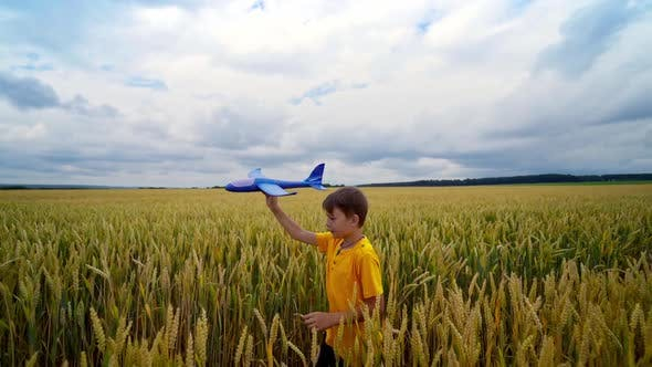 Thumbnail for Little boy with toy plane outdoors