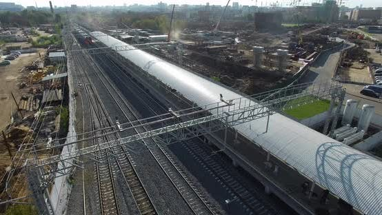 Thumbnail for Electric Train Arriving To the Station in City Outskirts, Aerial View