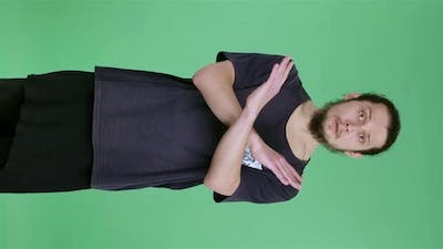 A Serious Young Man Crosses His Arms in a Stop Gesture and Says Stop and No