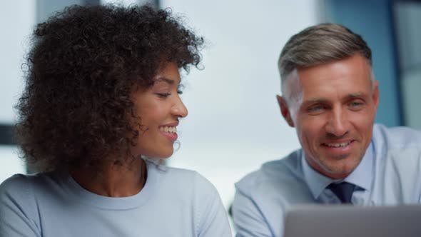 Thumbnail for Smiling Businesswoman and Businessman Having Video Conference with Partners