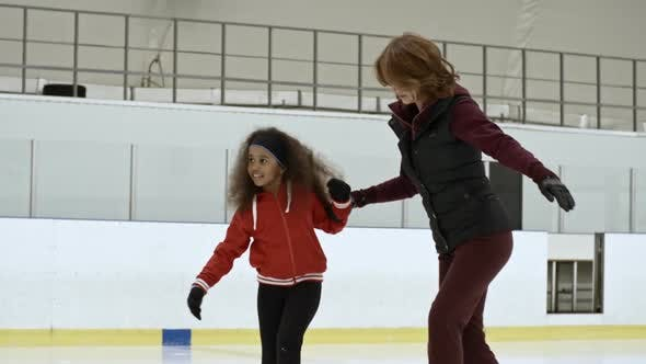 Cover Image for Professional Figure Skater Training Young Girl