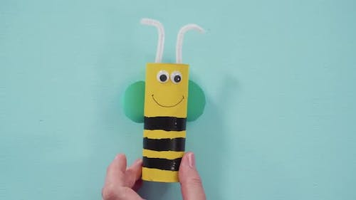 Papercraft project. Colorful bugs made out of empty toilet rolls.
