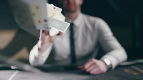 A Professional Croupier is Working with Cards
