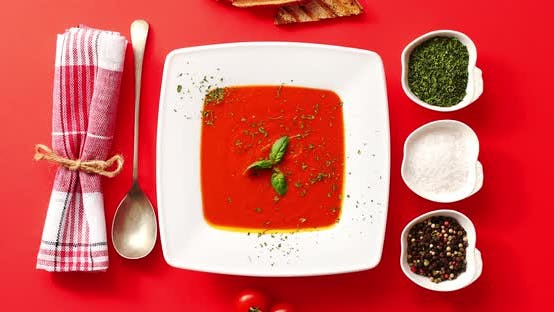Thumbnail for Tomato Soup Served in Plate with Spoon