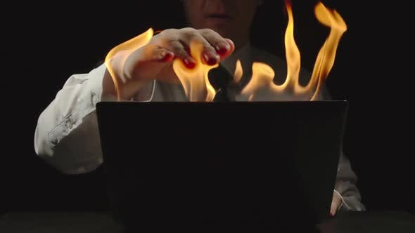 Thumbnail for Businessman Is Shutting Burning Laptop And Grabbing His Head
