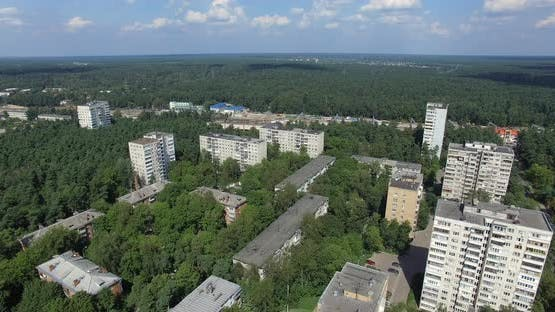 An Aerial View of Multi Storey Residential Buildings Drowning in Green Tree Crowns