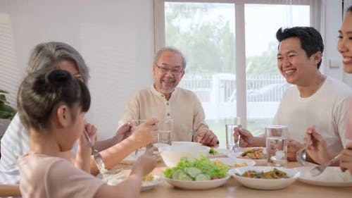 Multi-Generation relationship Asian Big happy family spend time have lunch on dinner table together