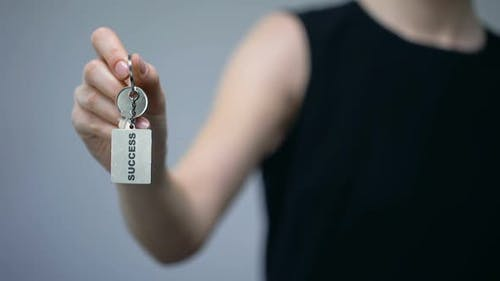 Success Inscription on Keychain in Woman Hand, Tips to Attract Money, Prosperity