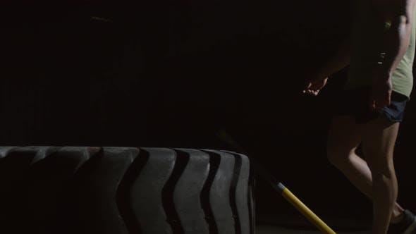 Thumbnail for Silhouette of sportsman Starting Sledgehammer Workout
