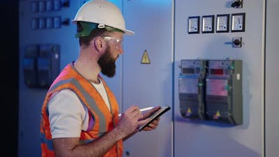 Worker of Electrical Engineering Service is Controlling Meter of Electricity