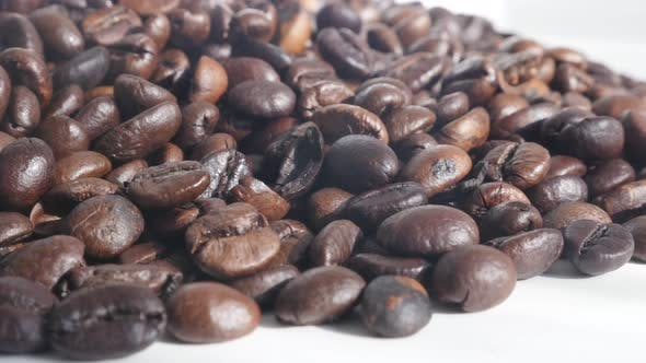 Thumbnail for High quality Arabica coffee beans on white 4K slow tilting footage