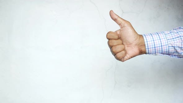 Man Hand Showing a Thumbup on White Background