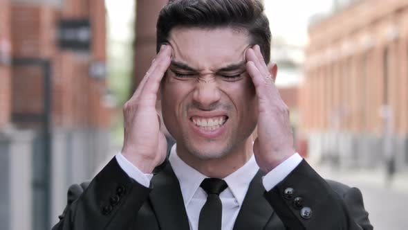 Cover Image for Headache, Tense Young Businessman Outdoor