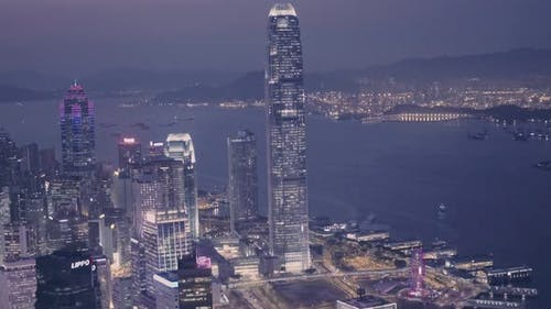 Hong Kong downtown city skyline and International Commerce Centre (ICC) at night. Aerial drone view
