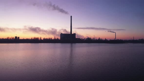 Thumbnail for Power Plant Smokestack at Sunrise. Environmental Pollution
