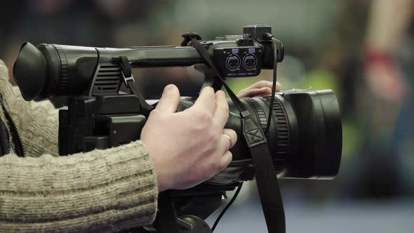Thumbnail for Cameraman with a Camera in Wrestling Competitions. Close-up.