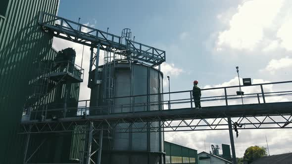 Agronomist Farmer Checking Grain Soybean and Wheat Storage Tanks