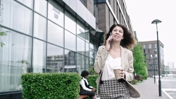 Thumbnail for Successful Business Lady Walking and Talking on Phone