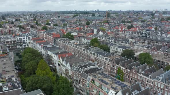 Thumbnail for Wide Aerial Establisher of Amsterdam Neighbourhood on Cloudy Fall Day