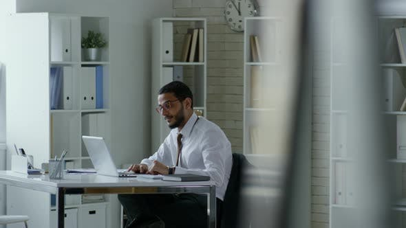 Thumbnail for Middle Eastern Businessman Working on Laptop in Office